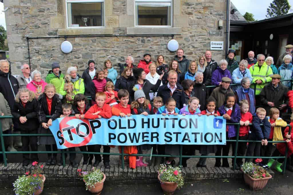 Children stood behind campaign banner